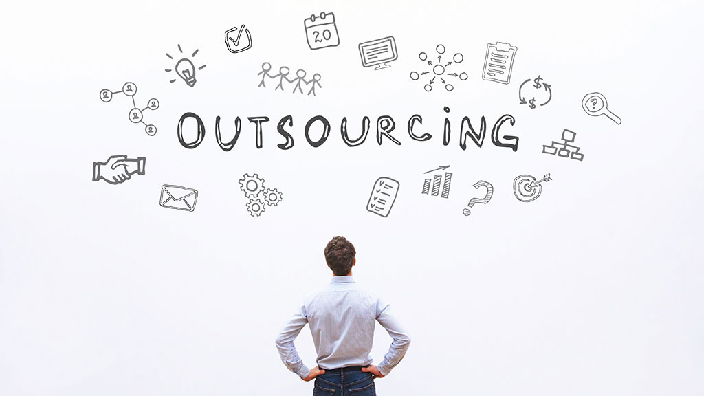 Man Facing White Wall with Outsourcing Text- Banner Image for Outsourcing: Addressing the Stigma Blog