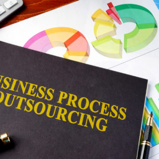 Book with Business Process Outsourcing Title - Banner Image for How the Insurance Industry Benefit from BPO Companies Blog