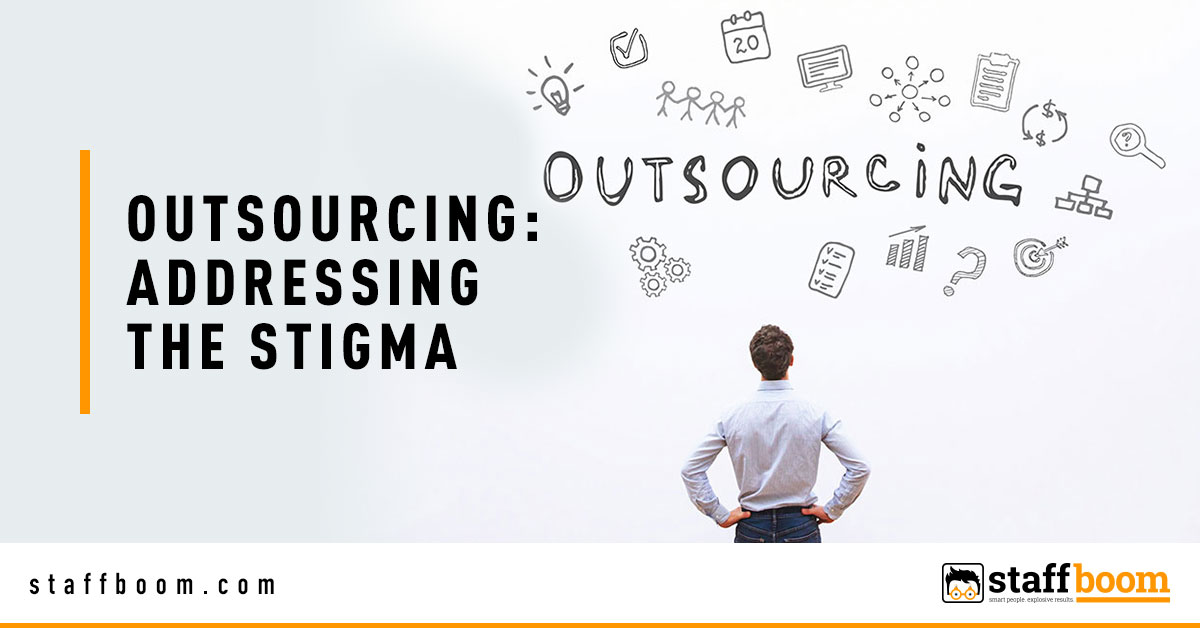 Man Facing Wall with Outsourcing Text - Banner Image for Outsourcing: Addressing The Stigma Blog